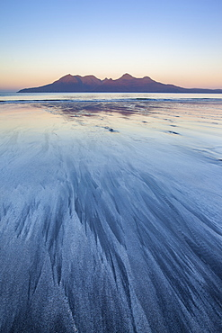 The Isle of Rum from Singing Sands on the Isle of Eigg, Small Isles, Inner Hebrides, Scottish Highlands, Scotland, United Kingdom, Europe