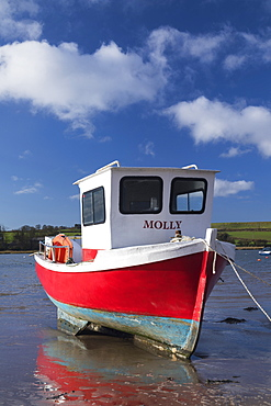 Traditonal Coble type fishing boat in the River Aln Estuary at Alnmouth, Northumberland, England, United Kingdom, Europe