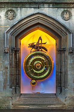 Night time view of the illuminated Corpus Christi Clock with Chronophage (Time Eater), Cambridge, Cambridgeshire, England, United Kingdom, Europe