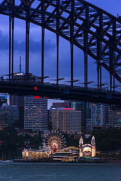 Sydney Harbour Bridge with Luna Park amusement park on North shore, Sydney, New South Wales, Australia, Pacific