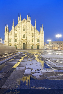 Milan Cathedral reflected in a puddle after a snowfall at twilight, Milan, Lombardy, Northern Italy, Italy, Europe