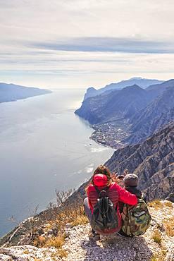 A couple take a photo at Cima Larici, Riva del Garda, Lake Garda, Trento province, Trentino-Alto Adige, Italian Lakes, Italy, Europe