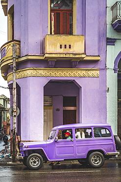 Pink building and pink vintage car in La Habana (Havana), Cuba, West Indies, Caribbean, Central America