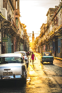 American and Russian vintage cars at sunset, La Habana (Havana), Cuba, West Indies, Caribbean, Central America