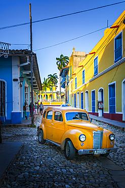 Yellow taxi in Trinidad, UNESCO World Heritage Site, Sancti Spiritus, Cuba, West Indies, Central America
