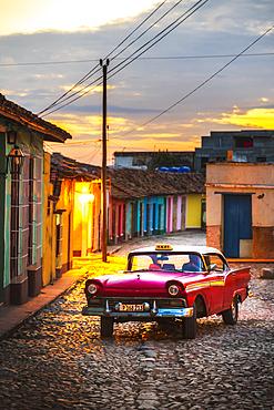 Vintage American taxi at dusk in Trinidad, UNESCO World Heritage Site, Sancti Spiritus, Cuba, West Indies, Central America