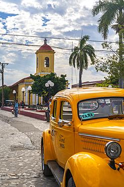Yellow vintage taxi in Trinidad, UNESCO World Heritage Site, Trinidad, Cuba, West Indies, Caribbean, Central America
