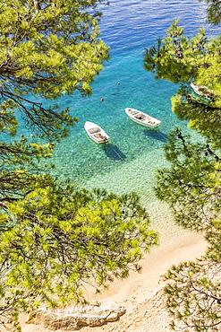 Two small boats anchored at Podrace Beach near Brela and Makarska, Croatia, Europe