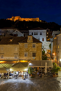 Elevated view over Svetog Stjepana square and the Spanish Fortress at night, Hvar, Croatia, Europe