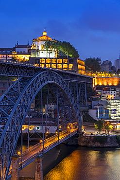 Dom Luis I Bridge and Serra do Pilar Monastery at dusk, Porto, Portugal, Europe