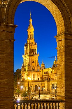 Illuminated Northern Tower at Plaza de Espana during dusk, Seville, Andalusia, Spain, Europe