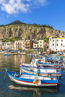 Colourful boats anchoring at the port of Mondello with view to Mount Gallo in the background, Palermo, Sicily, Italy, Europe