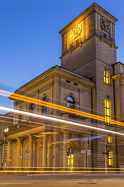 The clock tower of the Hamburg Chamber of Commerce building with traffic light trails during dusk, Hamburg, Germany, Europe