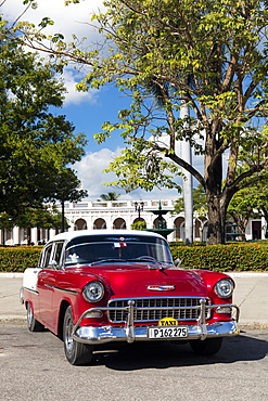 Red and white Chevrolet Bel Air parked by Plaza Jose Marti, Cienfuegos, UNESCO World Heritage Site, Cuba, West Indies, Caribbean, Central America