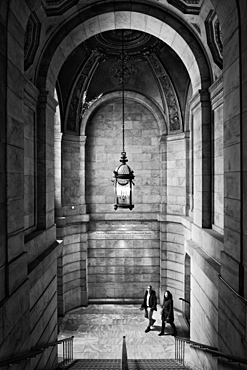 Two people walking up a staircase, New York Public Library, New York City, New York, United States of America, North America