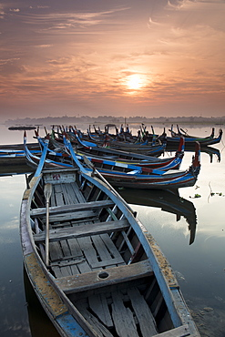 Fishing boats at sunrise on Lake Taungthaman near Amarapura, Myanmar (Burma), Asia