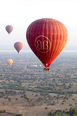 Hot air balloons fly over ancient Buddhist temples at dawn, Bagan (Pagan), Mandalay Region, Myanmar (Burma), Asia