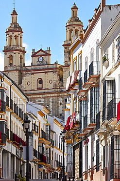 Church overlooking Semana Santa decorations on buildings, Olvera, Andalucia, Spain, Europe
