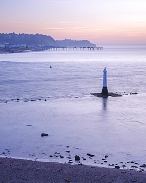 Early morning looking to Teignmouth with the Navigation mark at the entrance to the River Teign, viewed from Shaldon, Devon, England, United Kingdom, Europe