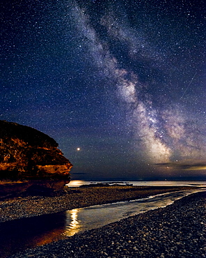 Milky Way with Mars set against Otter Head and River Otter at Budleigh Salterton, Devon, England, United Kingdom, Europe
