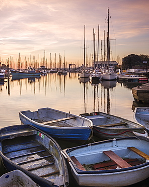 Early morning light upon the tenders, yachts and fishing boats at the Quay, Lymington, Hampshire, England, United Kingdom, Europe