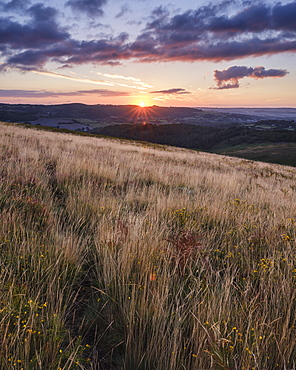 Sunrise from the grassy slopes of Trendlebere Down, Bovey Tracey, Devon, England, United Kingdom, Europe