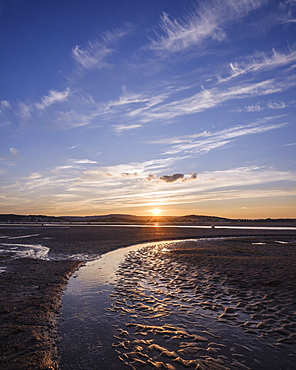 Looking at the setting sun across the Exe estuary towards Starcross from Exmouth, Devon, England, United Kingdom, Europe