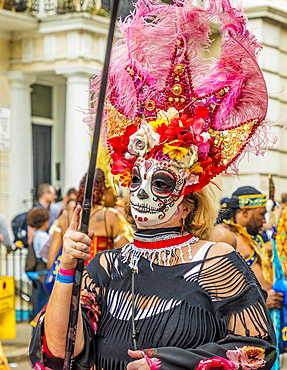A colourfully dressed participant taking part in the Notting Hill Carnival, London, England, United Kingdom, Europe