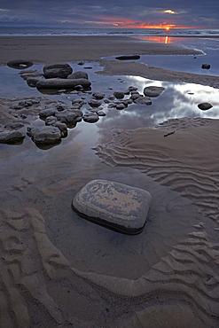 Tidal pools at sunset at Dunraven Bay, Southerndown, Glamorgan Heritage Coast, Wales, United Kingdom, Europe