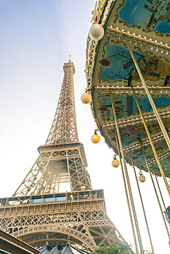 Eiffel tower with a classic carousel in the foreground early in the morning, Paris, France, Europe