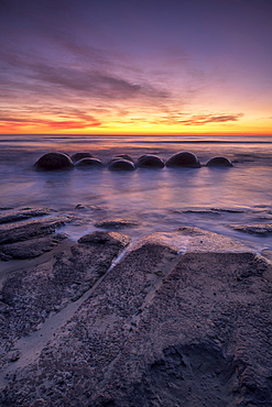 Epic sunrise at Moeraki Beach with the Moeraki Boulders, Moeraki Beach, Otago, South Island, New Zealand, Pacific