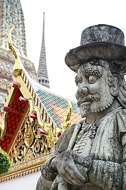 Close up of stone statue of guard in Wat Pho (Wat Phra Chetuphon) (Temple of the Reclining Buddha), Bangkok, Thailand, Southeast Asia, Asia