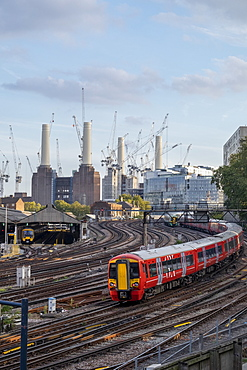 Gatwick Express passenger train travelling towards London Victoria station with Battersea Power Station under construction, London, England, United Kingdom, Europe