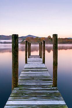 Wooden jetty at dawn, Derwentwater, Lake District National Park, UNESCO World Heritage Site, Cumbria, England, United Kingdom, Europe