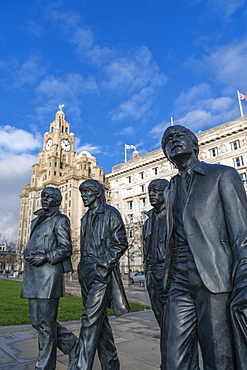 Bronze statues of the Beatles stand on Liverpool Waterfront, Liverpool, Merseyside, England, United Kingdom, Europe