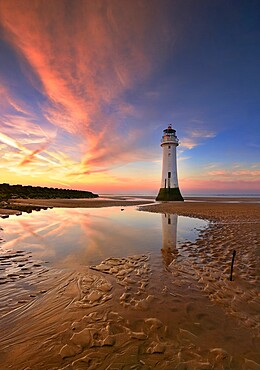 Perch Rock Lighthouse reflected at sunset, New Brighton, Cheshire, England, United Kingdom, Europe