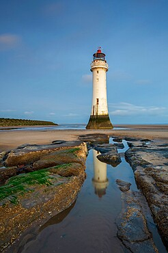Perch Rock Lighthouse reflected in rockpool, New Brighton, Cheshire, England, United Kingdom, Europe