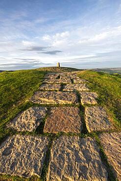 Stone path leading towards the summit and trig point at Mam Tor, High Peak, Derbyshire, England, United Kingdom, Europe