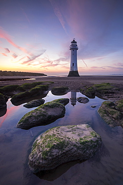 Perch Rock Lighthouse at New Brighton reflected with dramatic sunset, New Brighton, Cheshire, England, United Kingdom, Europe