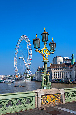 View of lamp post on Westminster Bridge with The London Eye, Westminster, London.