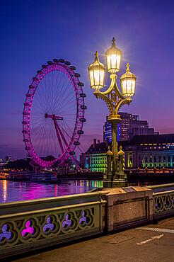 The London Eye with ornate lamp post on Westminster Bridge, London