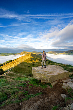 A walker stood admiring the view across The Great Ridge and Mam Tor, Peak DIstrict, Derbyshire