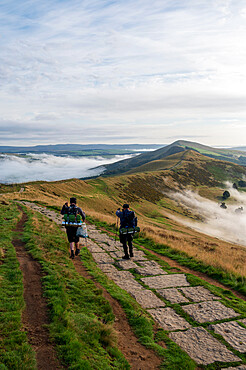Hikers on The Great Ridge with cloud inversion, Edale, The Peak District, Derbyshire