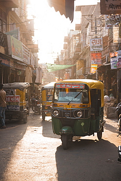 Tuk Tuks at sunset ride through the tiny streets of Jodhpur, Rajasthan, India, Asia