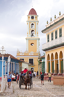 Street scene at Plaza Mayor with St. Francis Church in the background, Trinidad, UNESCO World Heritage Site, Cuba, West Indies, Caribbean, Central America