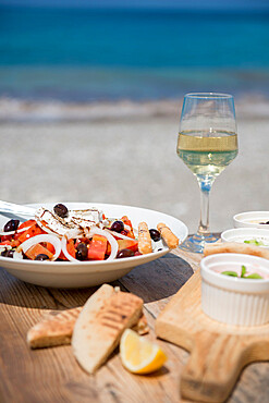 Cypriot Village Salad by the sea served with pitta bread and white wine, Cyprus, Mediterranean, Europe