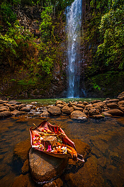 An offering is made to the gods at this sacred pool in Hawaii.
