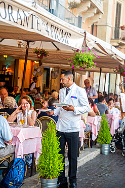 Waiter serving at outdoors restaurant table, Piazza Navona, Rome, Lazio, Italy, Europe