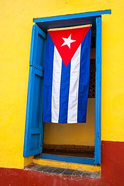 Cuban flag in doorway, Trinidad, Sancti Spiritus, Cuba, West Indies, Central America