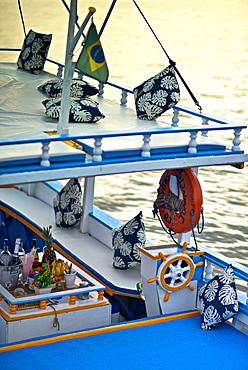 Colourful wooden boats take tourists exploring Paraty Bay, Paraty, Rio de Janeiro State, Brazil